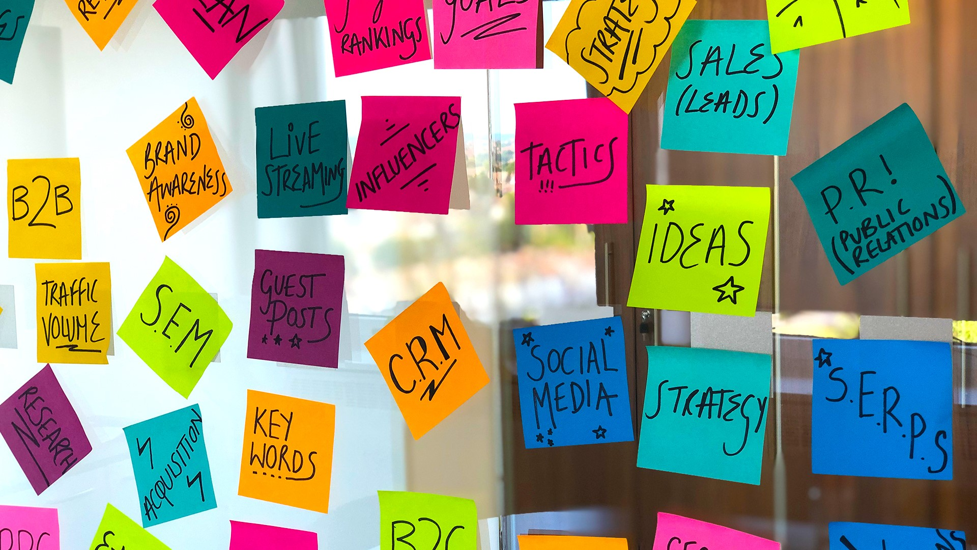 Post it notes with marketing terms written