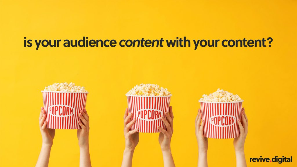 hands holding popcorn in a yellow background