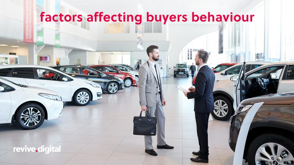 man talking to a car dealer surrounded with cars